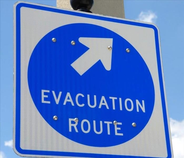"A blue traffic sign that reads, ""Evacuation Route"""
